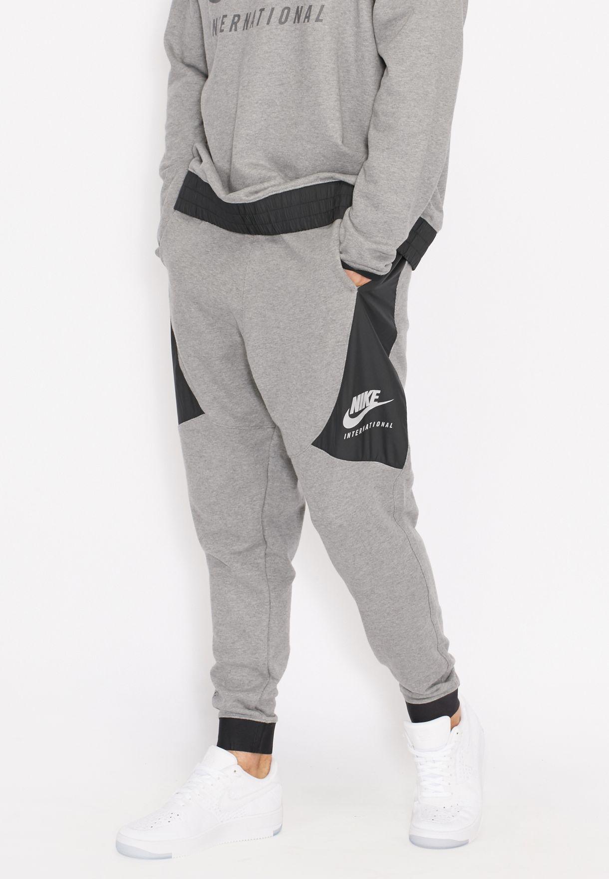 1c1949f588d5 Shop Nike grey International Cuffed Sweatpants 802375-091 for Men in ...