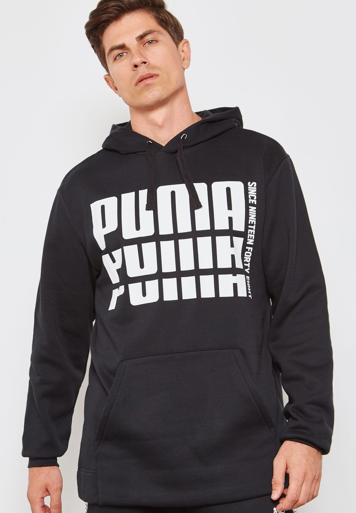 1dd200aabee3 Shop PUMA black Rebel Bold Hoodie 85338701 for Men in Bahrain ...