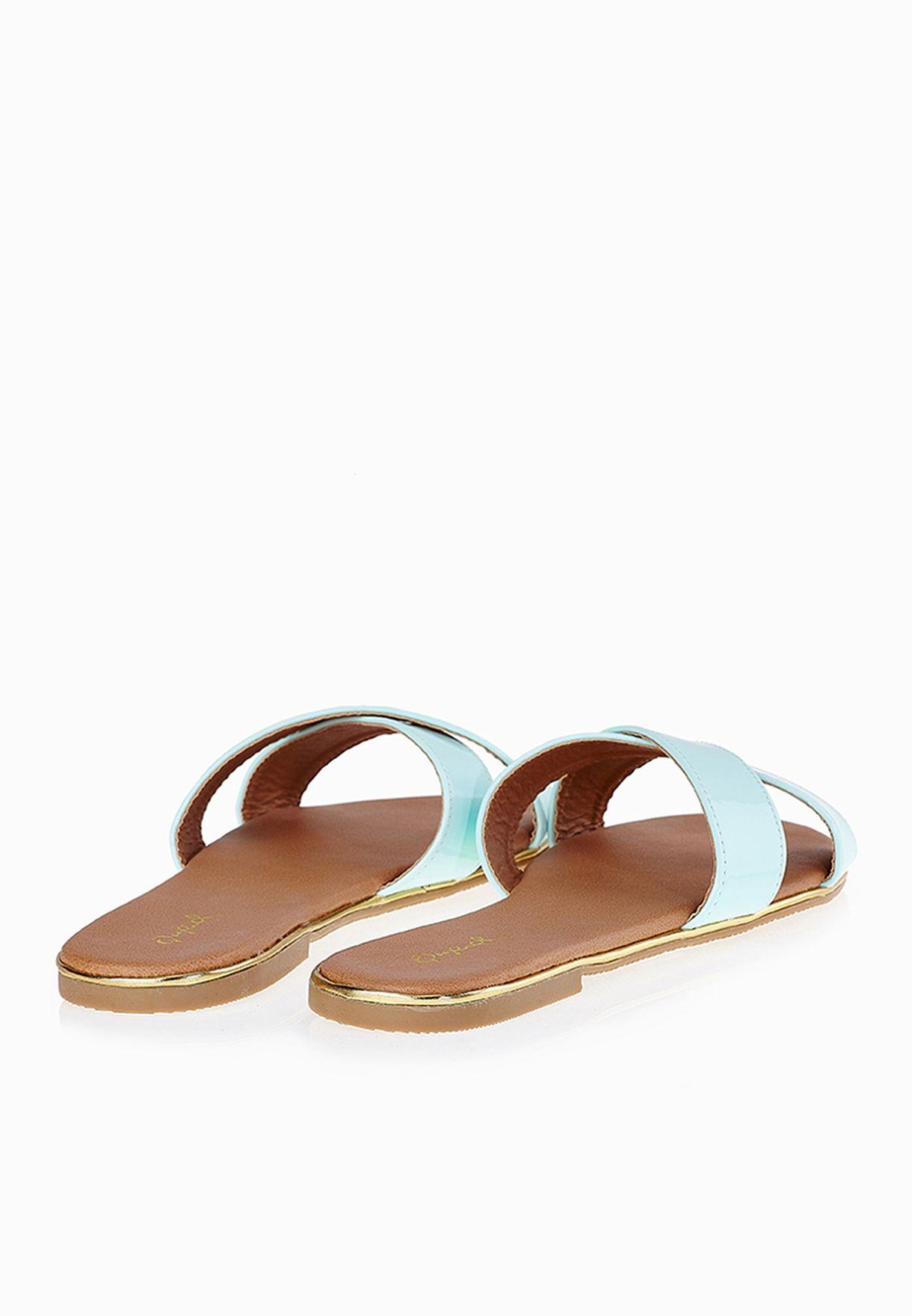 43b32ee2f0f4 Shop Qupid blue Cross Strap Slide Sandals for Women in Oman ...