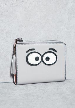 محفظة مزينة بعيون كرتونية