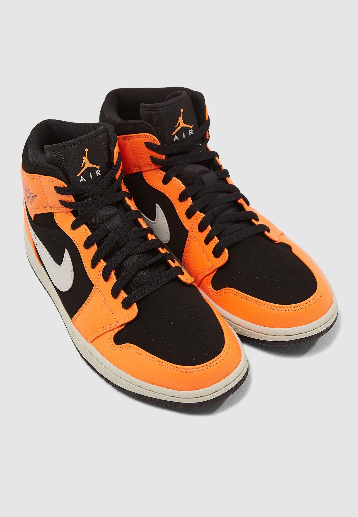 972a71867c8 Shop Nike orange Air Jordan 1 Mid 554724-062 for Men in Saudi ...