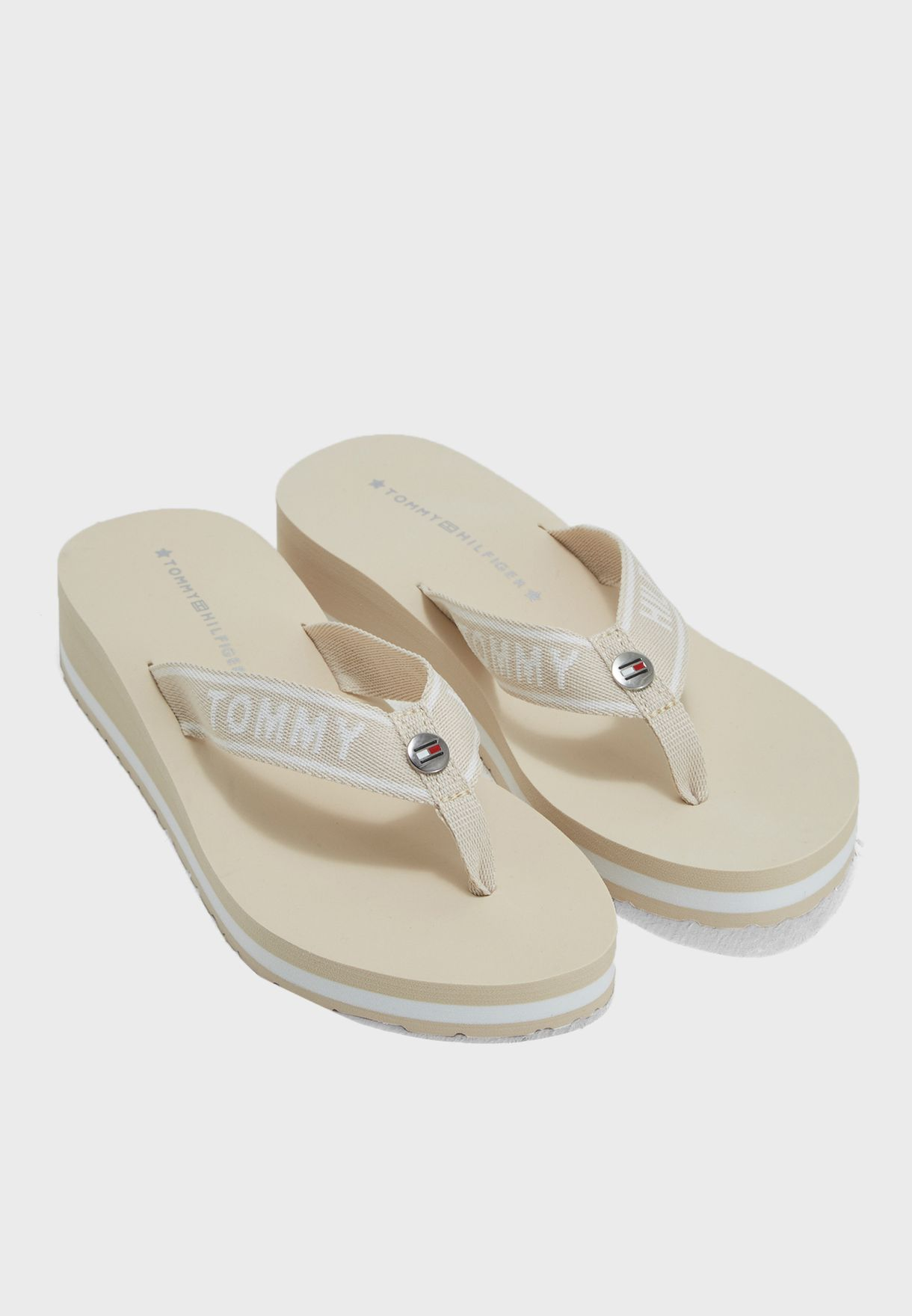 27123a496c01b1 Shop Tommy Hilfiger beige Tommy Branding Beach Sandal FW0FW02953 for Women  in Saudi - TO279SH82PPP