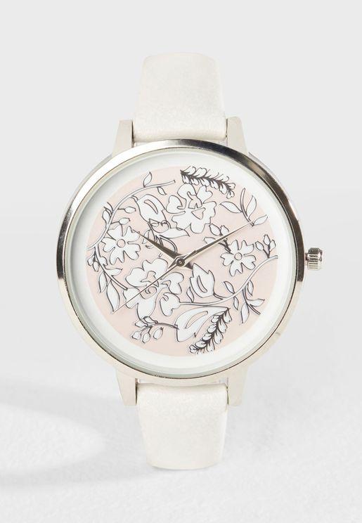 ساعة عصرية مزينة بأزهار