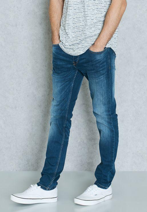 بنطال جينز بضربات باهتة