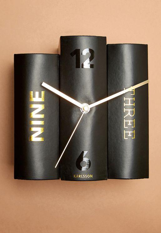 ساعة بشكل كتاب