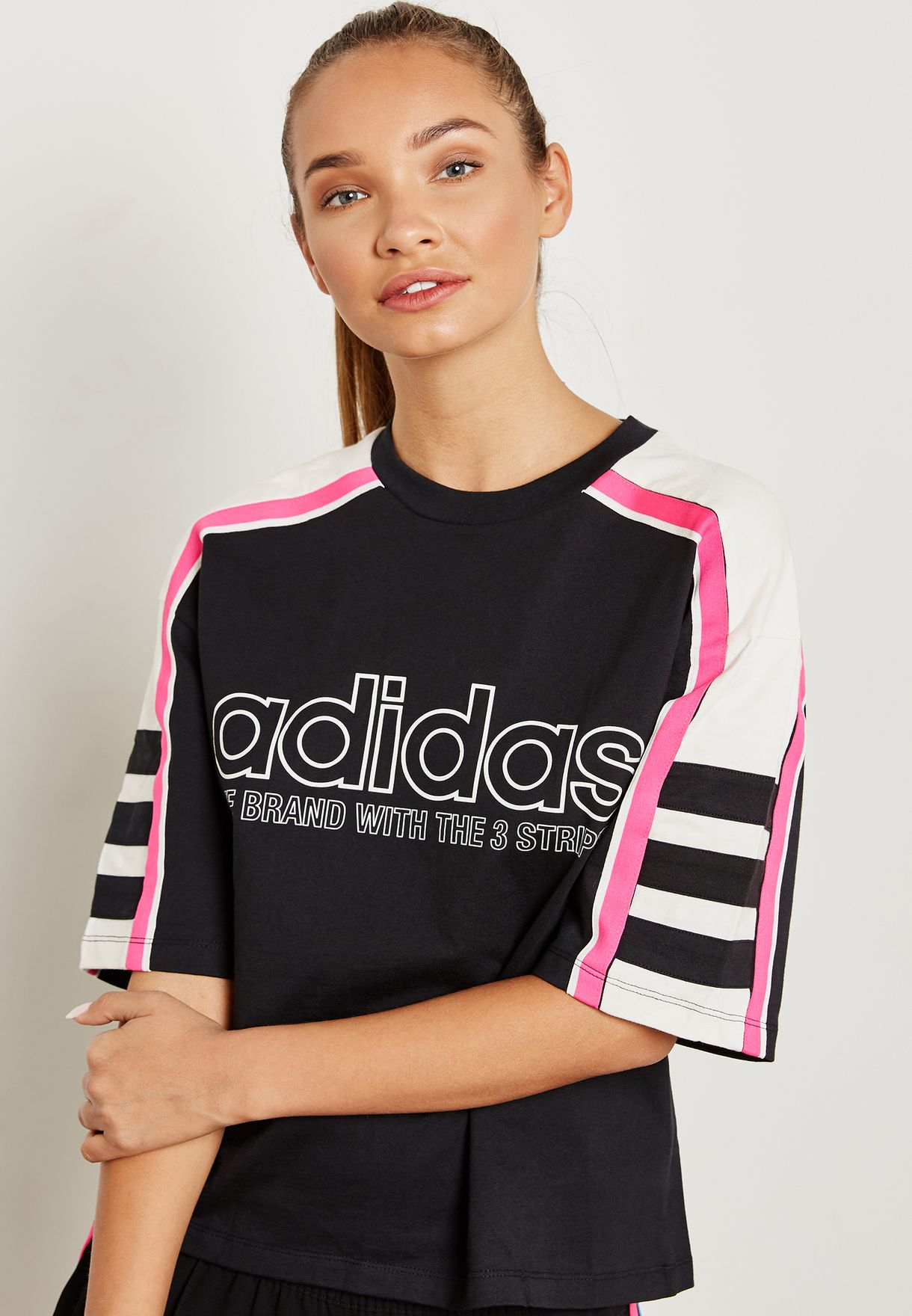 7fd534c3 Shop adidas Originals black OG Racing T-Shirt DH4183 for Women in ...