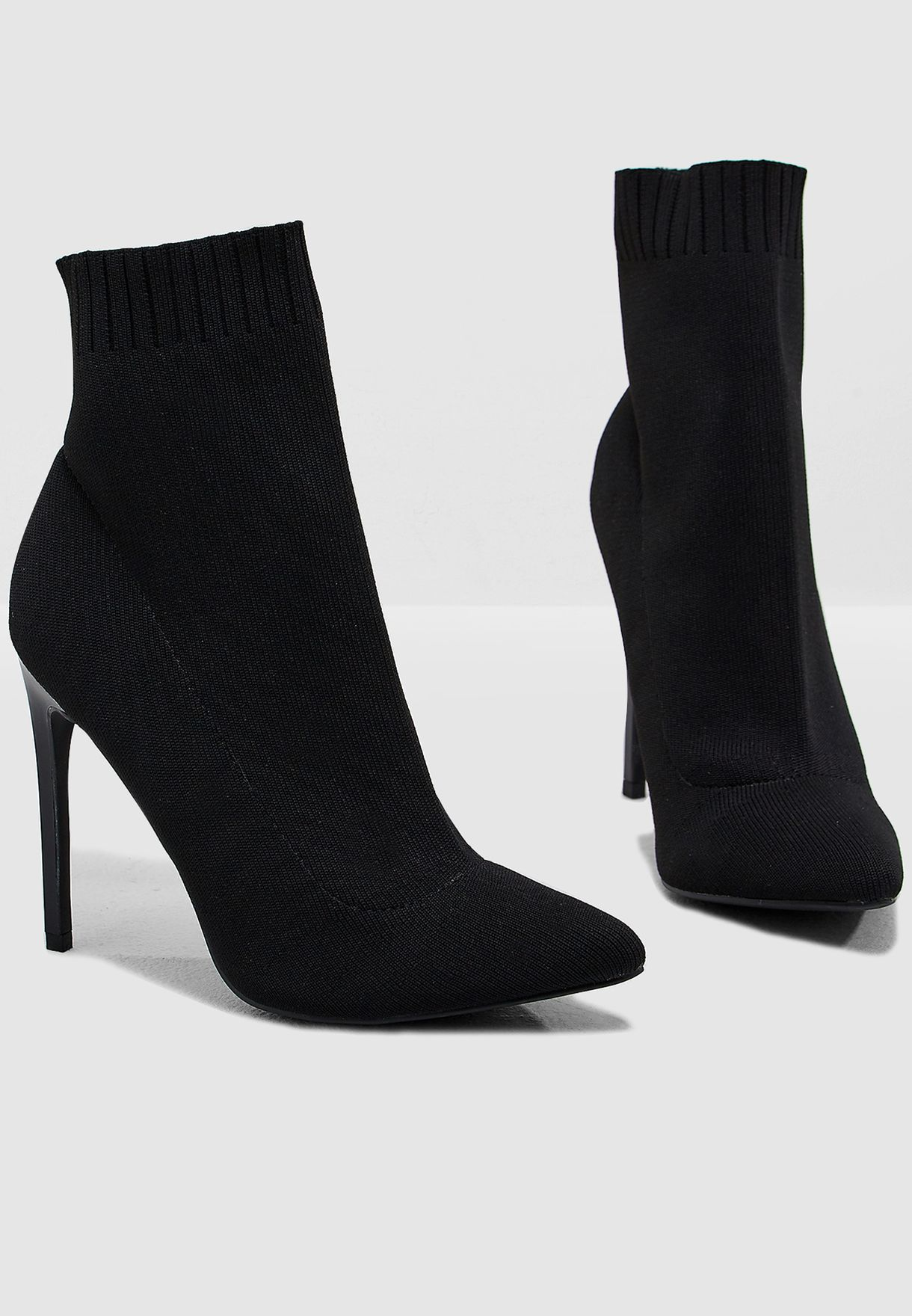 Buy Missguided black Knitted Sock Boot