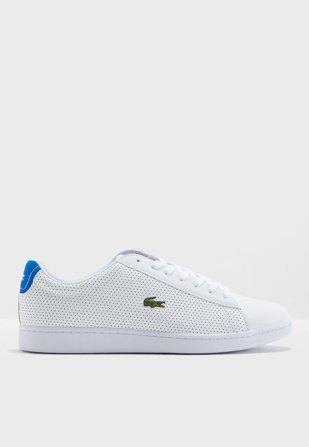 6e916034e Shop Lacoste white Carnaby Evo Sneakers 35SPM0008-080 for Men in UAE ...