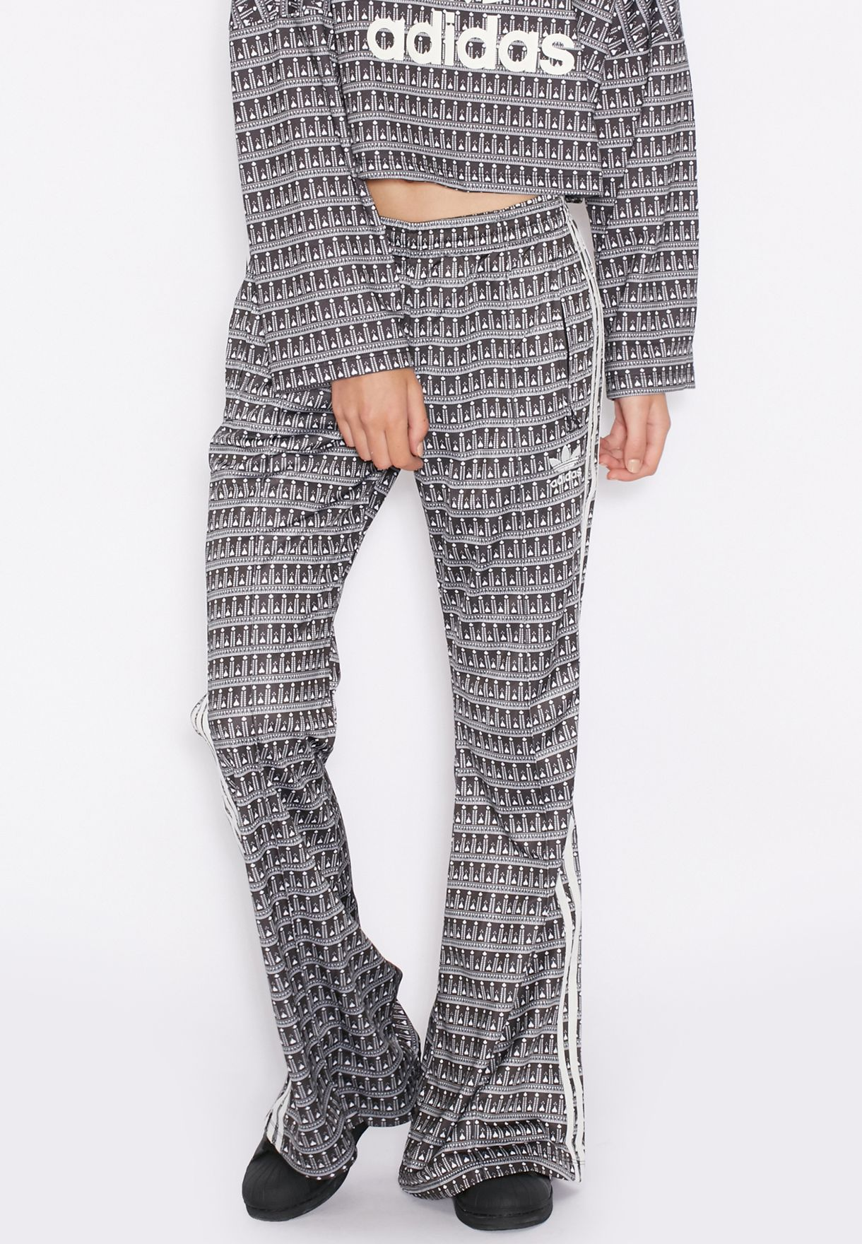 38d79bd1be13f2 Shop adidas Originals grey Pavao Flared Pants AY6866 for Women in ...