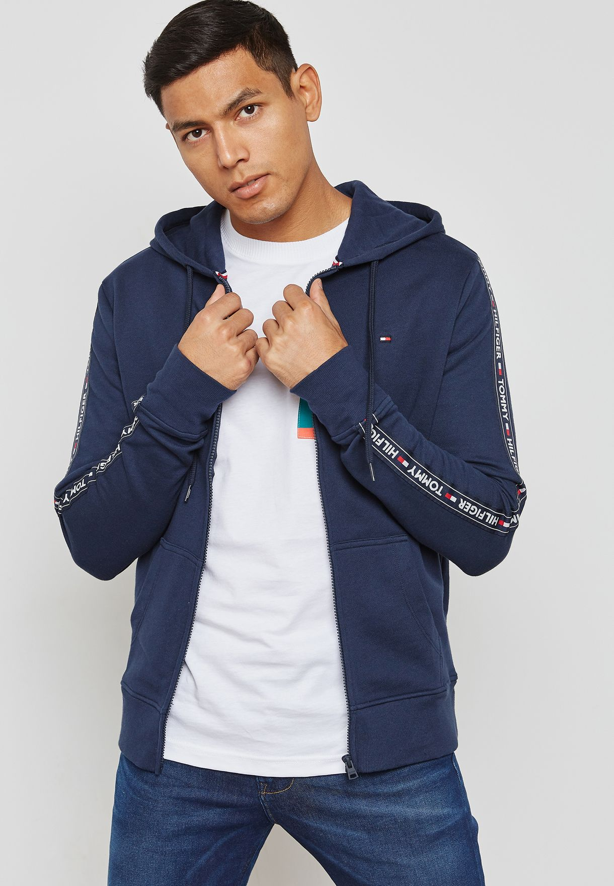 400b528563f5 Shop Tommy Hilfiger navy Zip Through taped Hoodie UM0UM00708 for Men ...