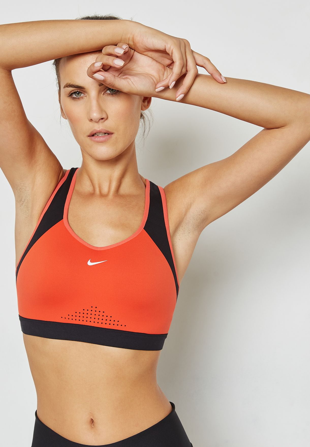 0ce5a3f952415 Shop Nike orange Motion Adapt Bra 888575-634 for Women in Oman -  NI727AT01ZCC