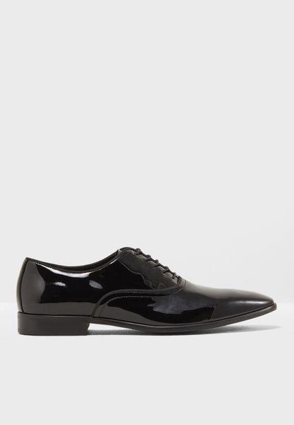 حذاء رسمي لامع بأربطة