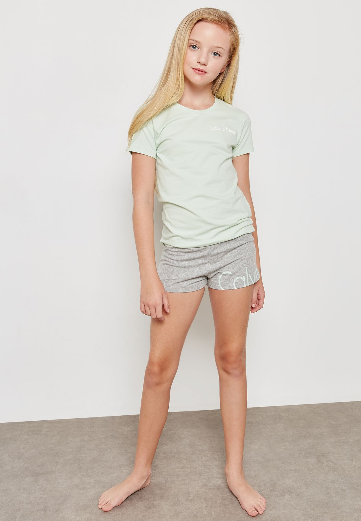 c299e3b6205d9 Shop Calvin Klein green Teen T-Shirt + Shorts Set G80G800172 for ...