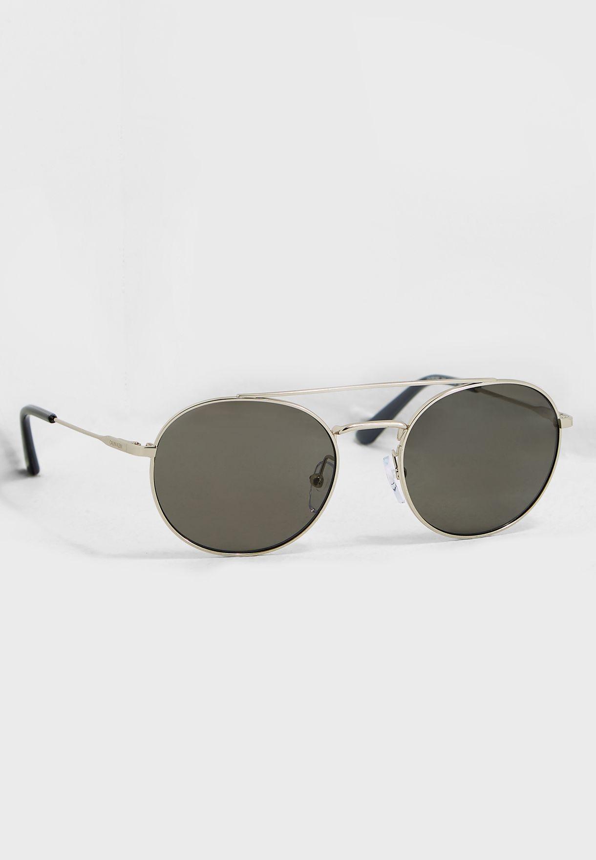 00a059f76c94 Shop Calvin Klein silver Round Sunglasses CK18116S-045 for Men in ...