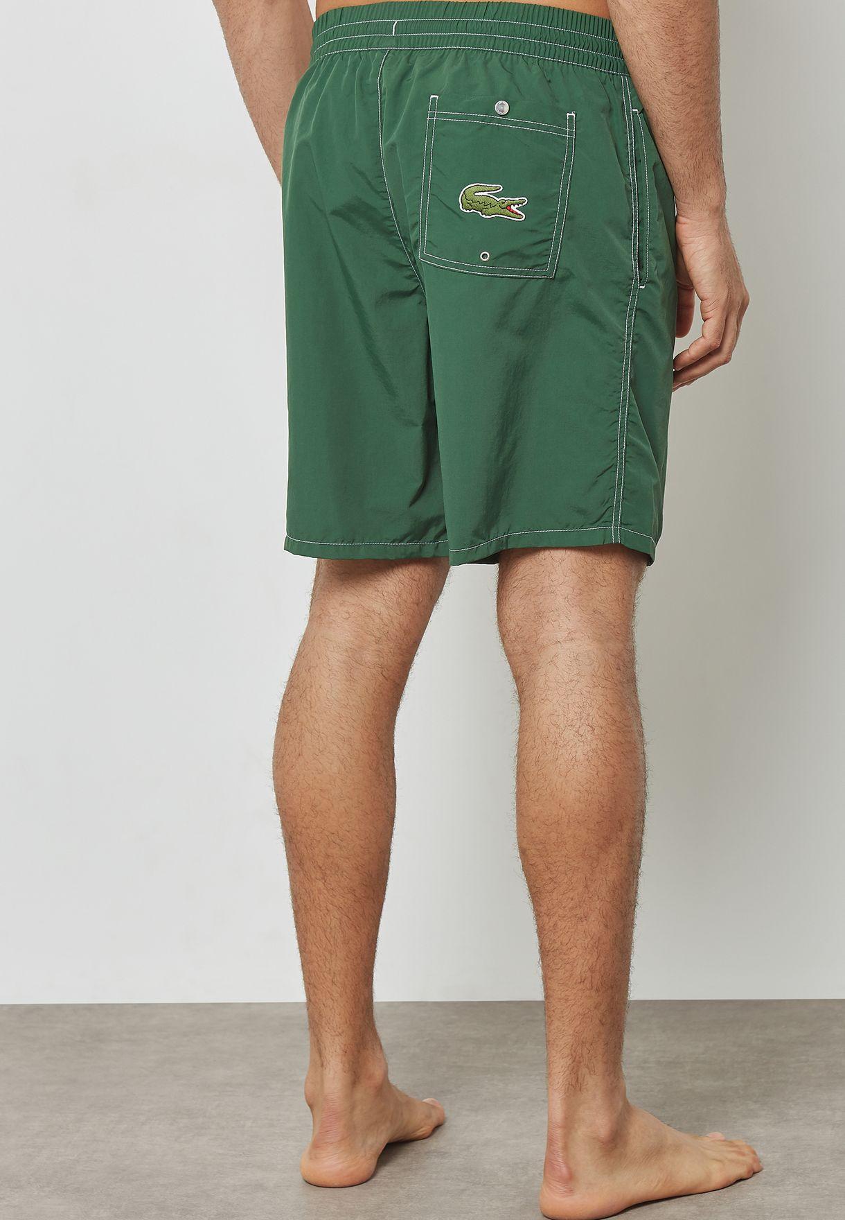 c01e208029 Shop Lacoste green Lacoste Print Swim Shorts MH4211-132 for Men in ...