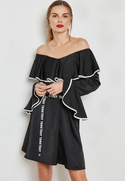 فستان بحواف كشكش وحزام