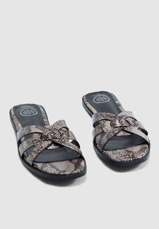 417da824122 Criss Cross Sandals In Snake. Ginger