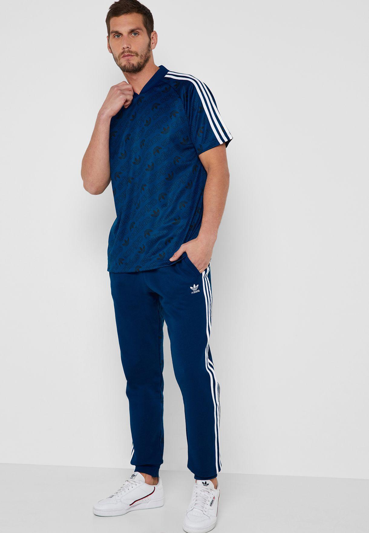 f4b66408c2565 Shop adidas Originals blue Monogram Sweatpants DV2076 for Men in ...
