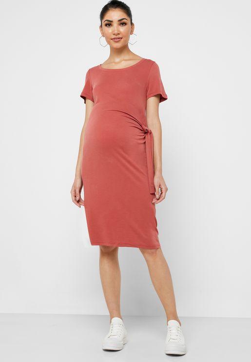 فستان مزين بعقدة جانبية