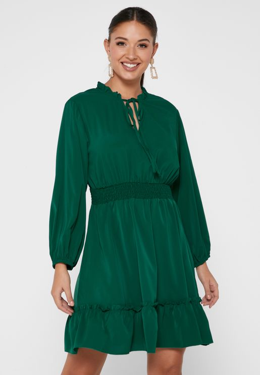 Dress With Cinched-In Waist And Tiered Hemline