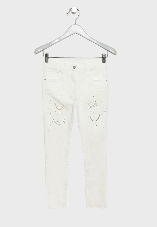 جينز مزين بسلاسل معدنية
