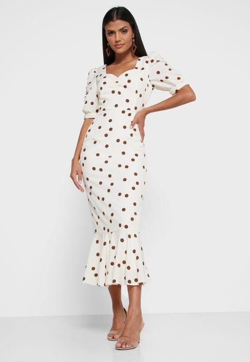 فستان منقط بأكمام منفوشة