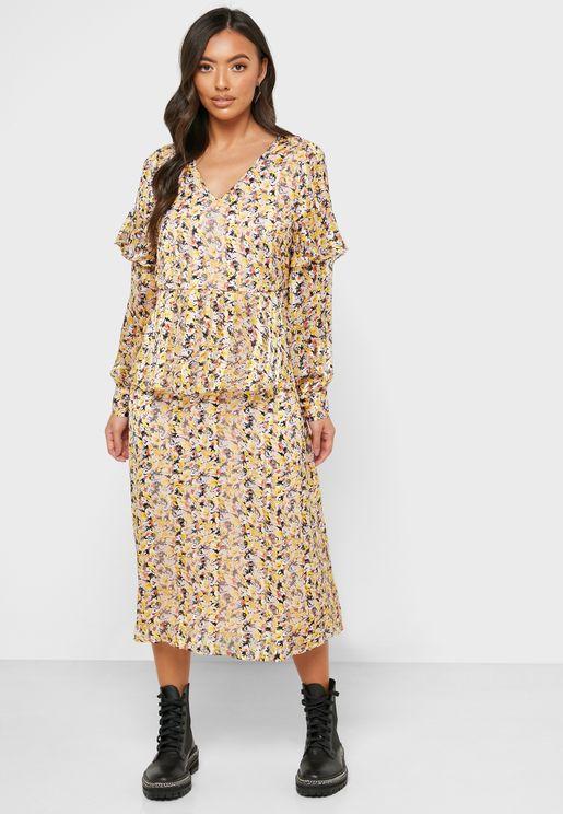 فستان مطبع باطراف غير متماثلة