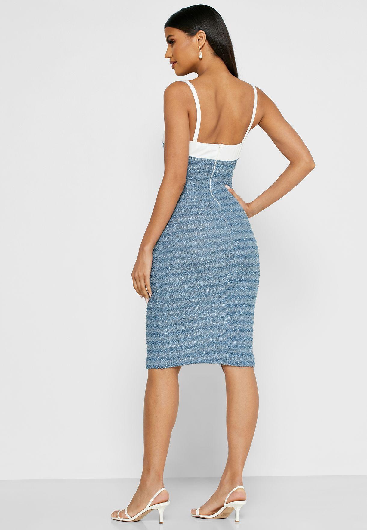 فستان ميني بأزرار واطراف مغايرة