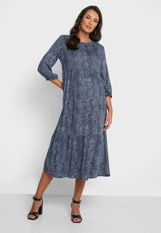 فستان بطبعات وكشكش