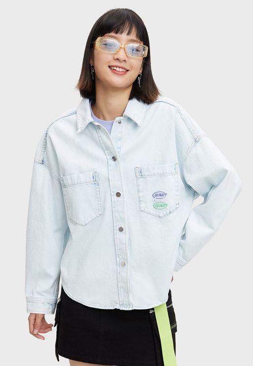 قميص دنيم بأزرار