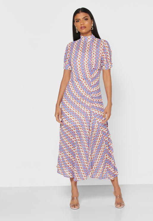 فستان بطبعات ازهار وازرار