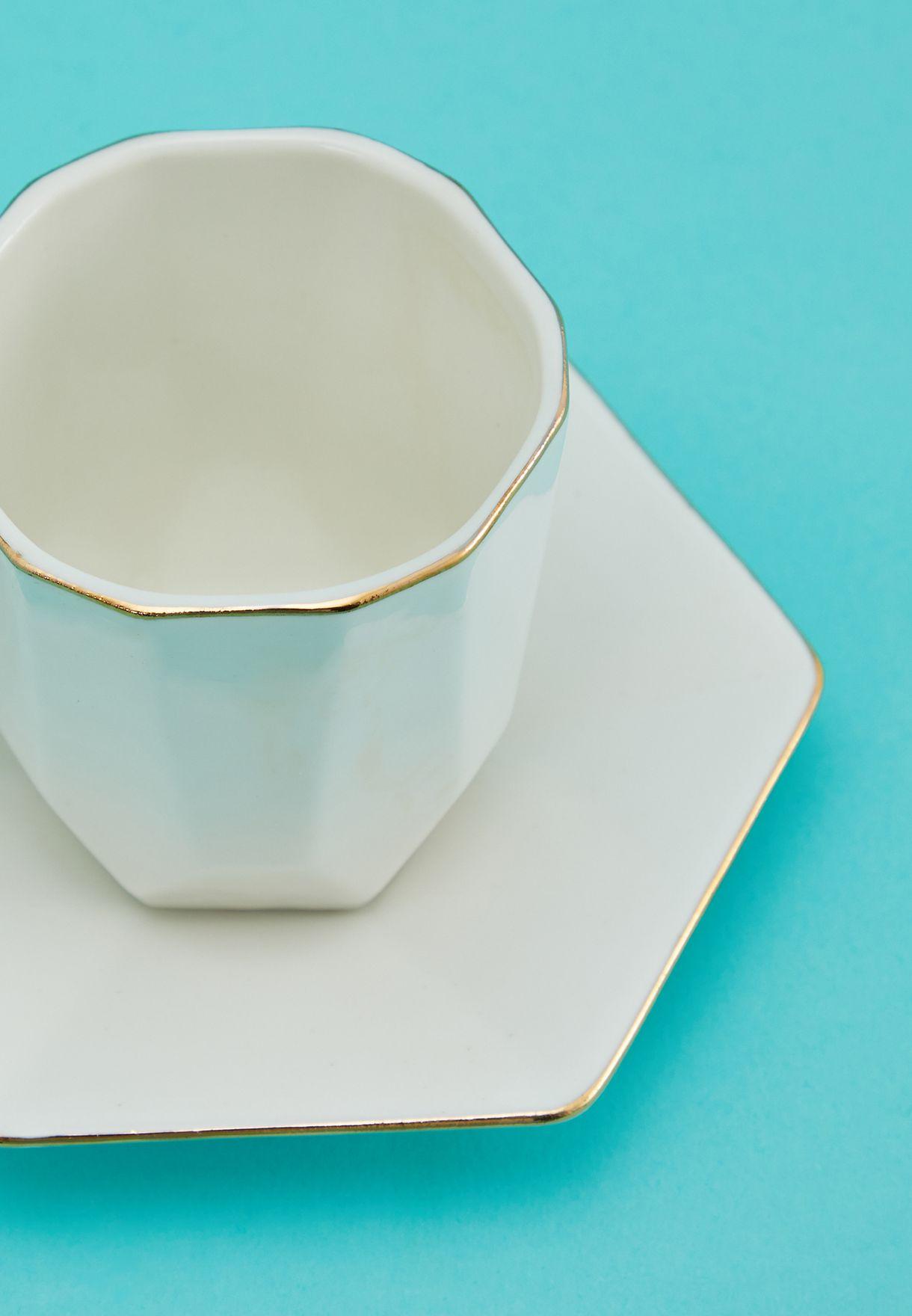طقم من فنجان وطبق بطبعات نخيل