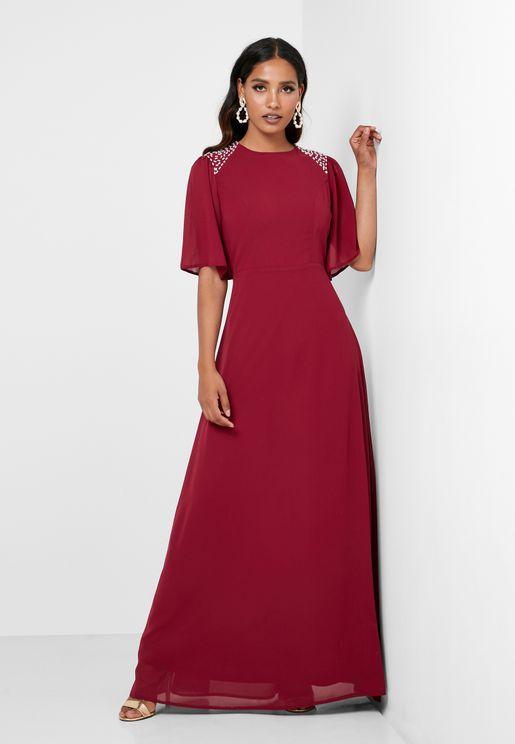 فستان مزين بلؤلؤ على الاكتاف