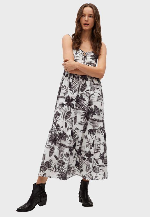 فستان بطبعات وحمالات عريضة