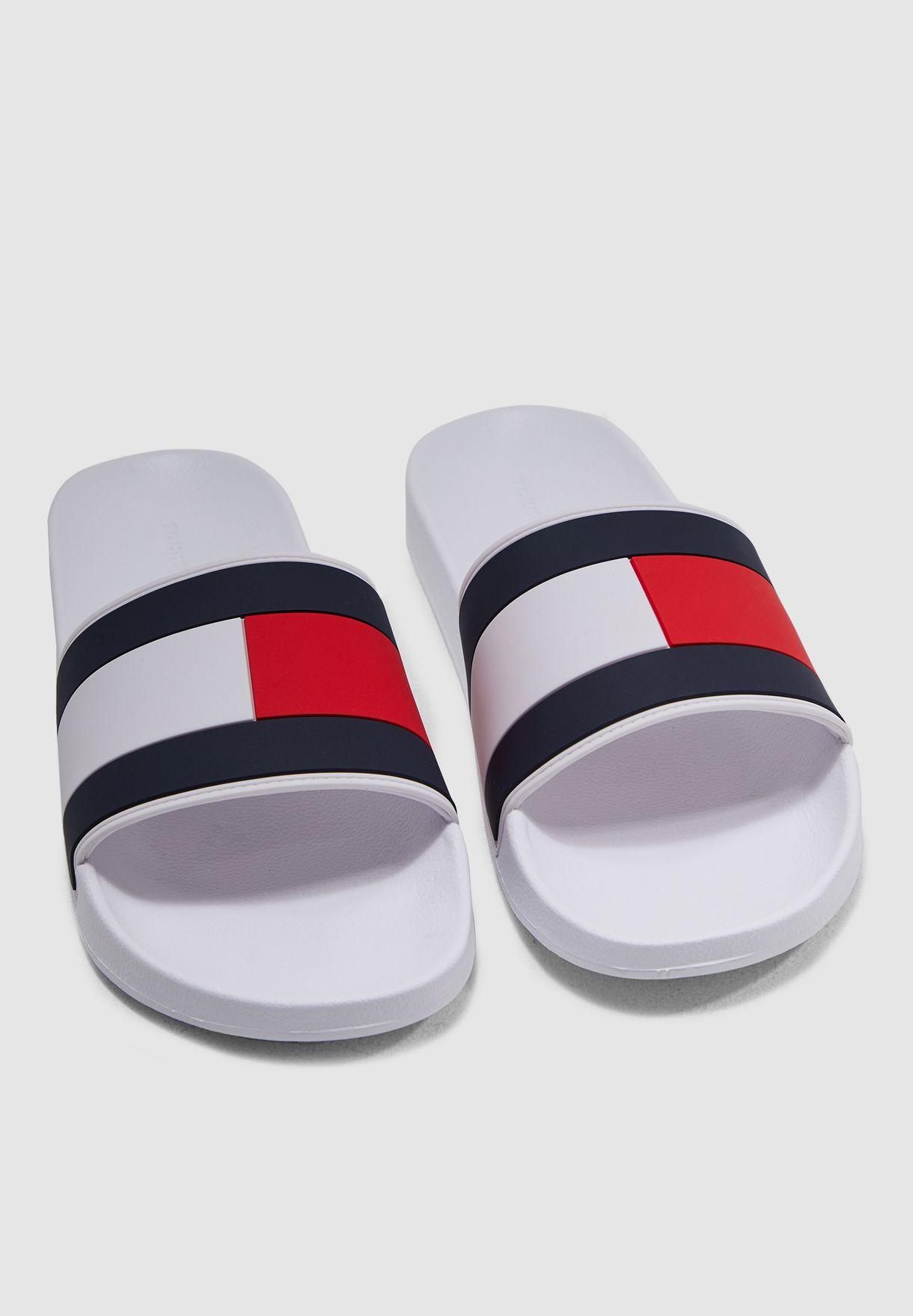 bedf5732467e1 Shop Tommy Hilfiger white Essential Flag Pool Slides FM0FM02327100 ...