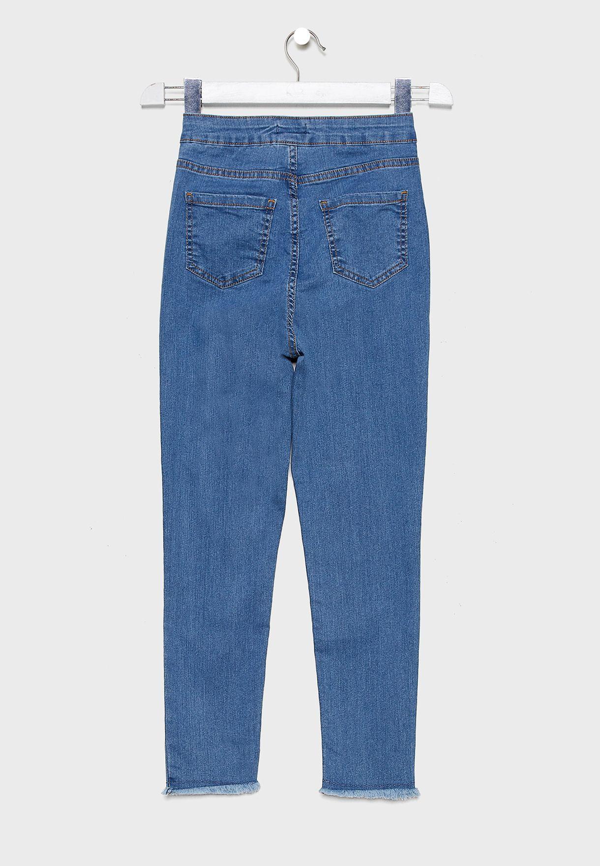 بنطال جيغنز بأطراف مشرشبة