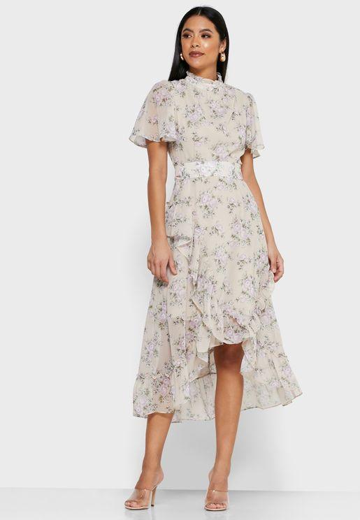 فستان بطبعات ازهار واطراف غير متماثلة