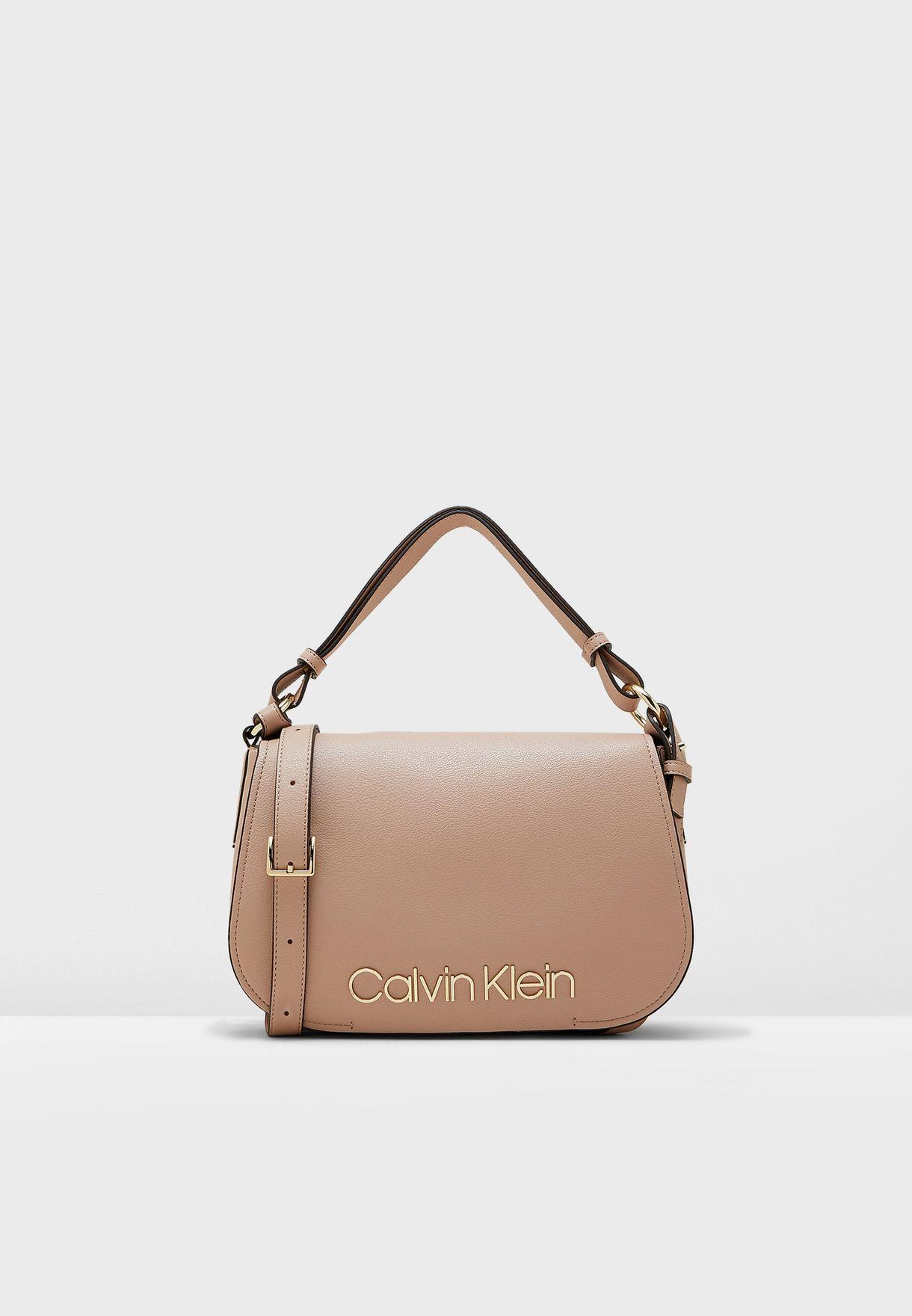 b48c989c84 Shop Calvin Klein beige Dressed Up Satchel K60K605373 for Women in ...