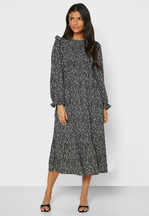 فستان مطبع باجزاء مزمومة