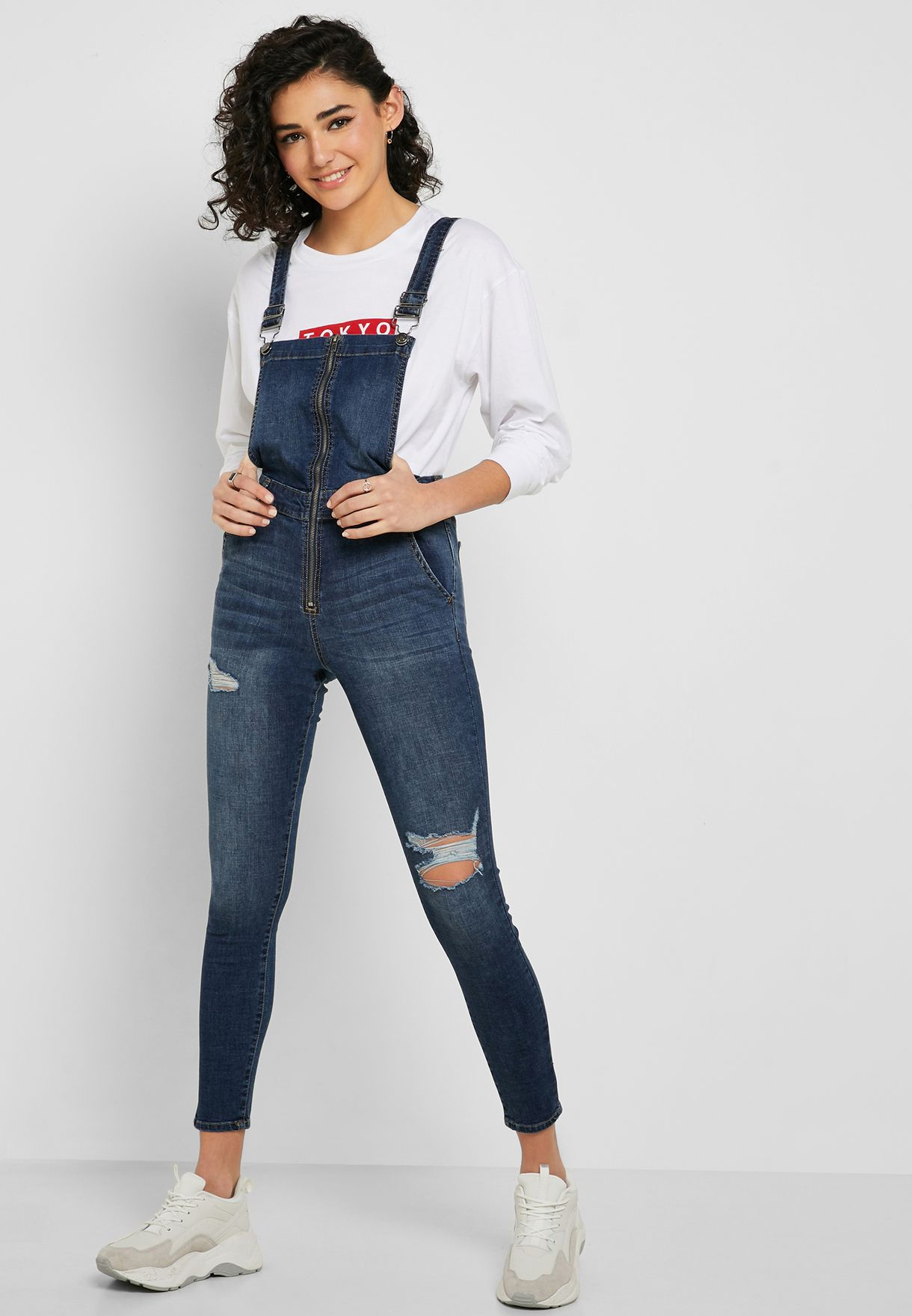 e0402277eca Shop Forever 21 blue Distressed Denim Jumpsuit 317187 for Women in ...