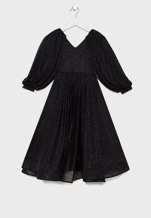 فستان بطبعات وياقة V