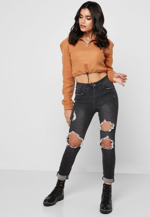 جينز بخصر عالي ونمط ممزق