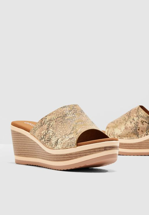 Wedged Mule Sandal In Snake Print