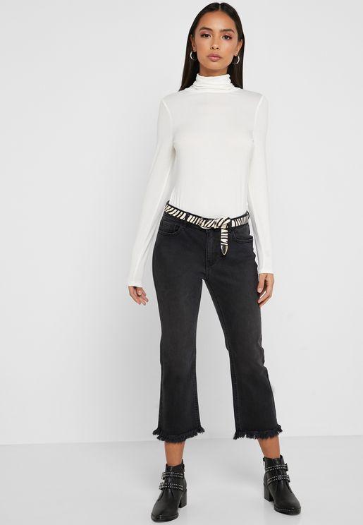 جينز بطول حتى الكاحل وحافة غير مدروزة
