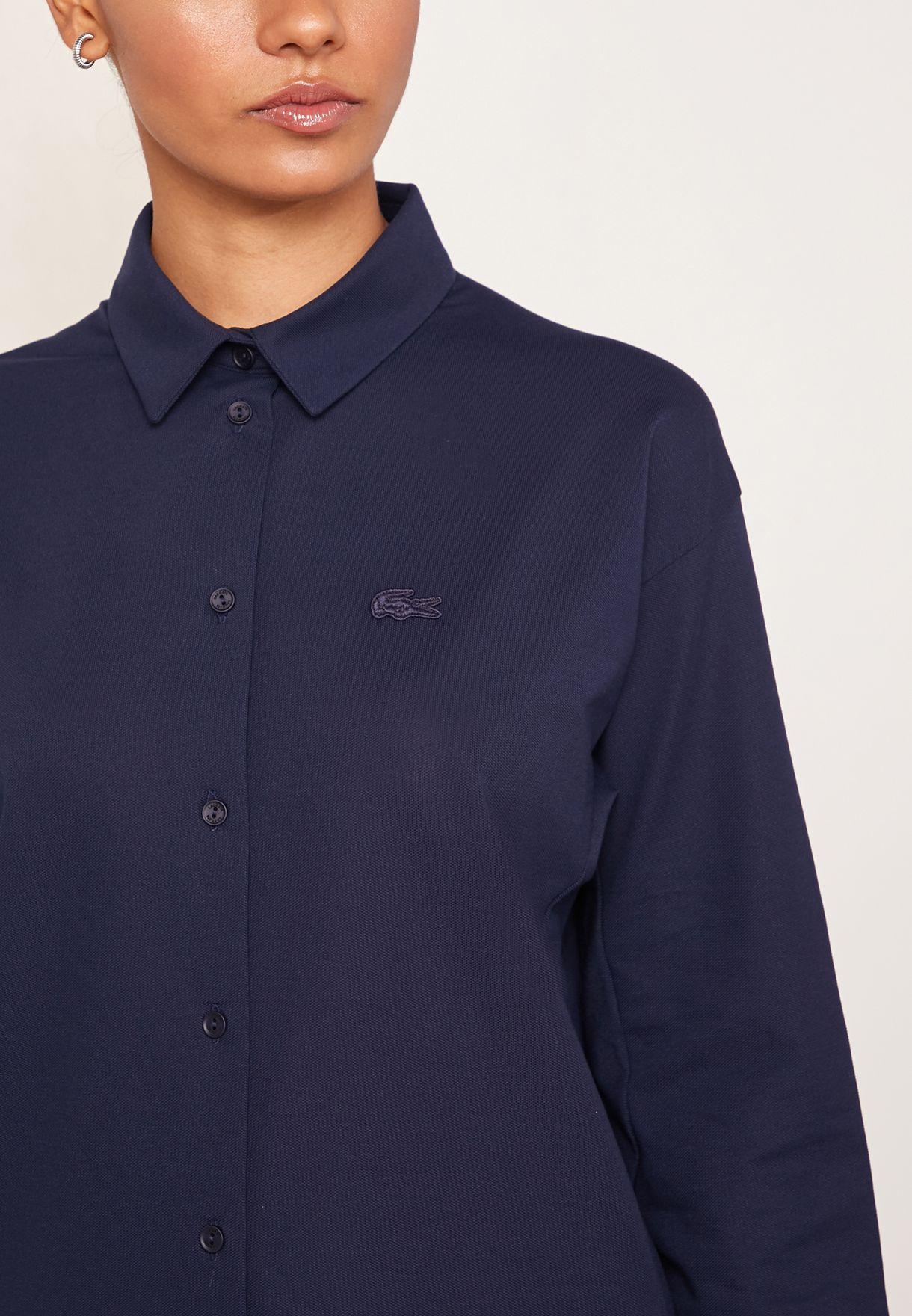 قميص بازرار مزين بشعار الماركة