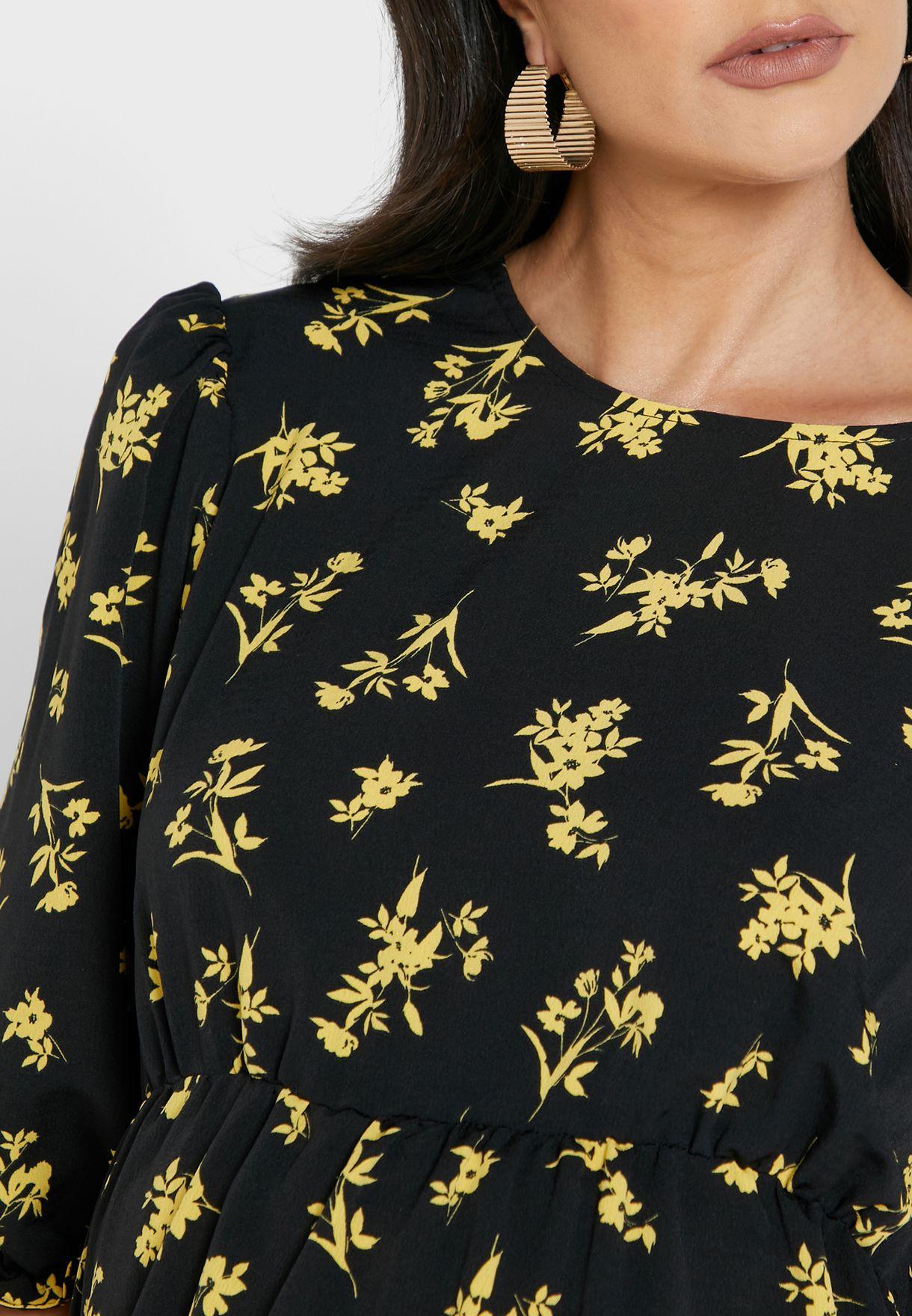 فستان بكشكش وطباعة زهور
