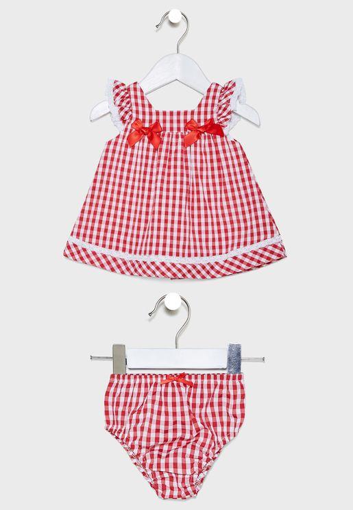 طقم (فستان بطبعة ورود + سروال)