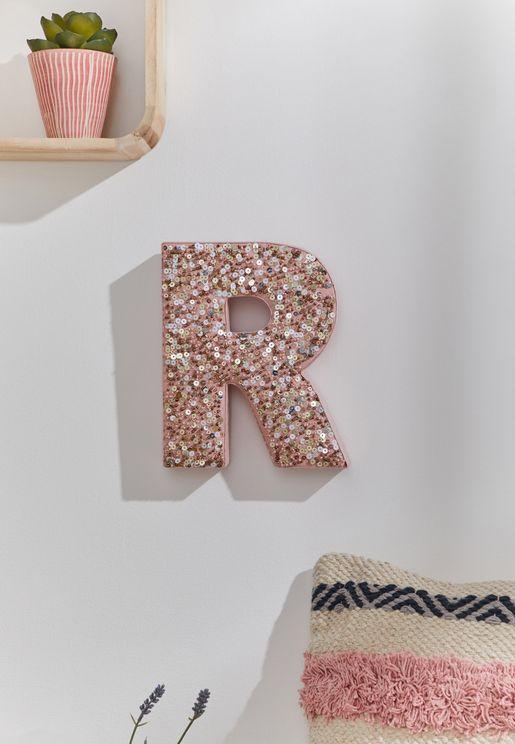 حرف R للتعليق