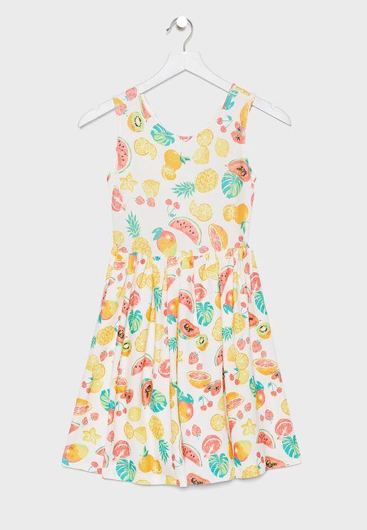 فستان بطبعات واربطة متقاطعة في الخلف