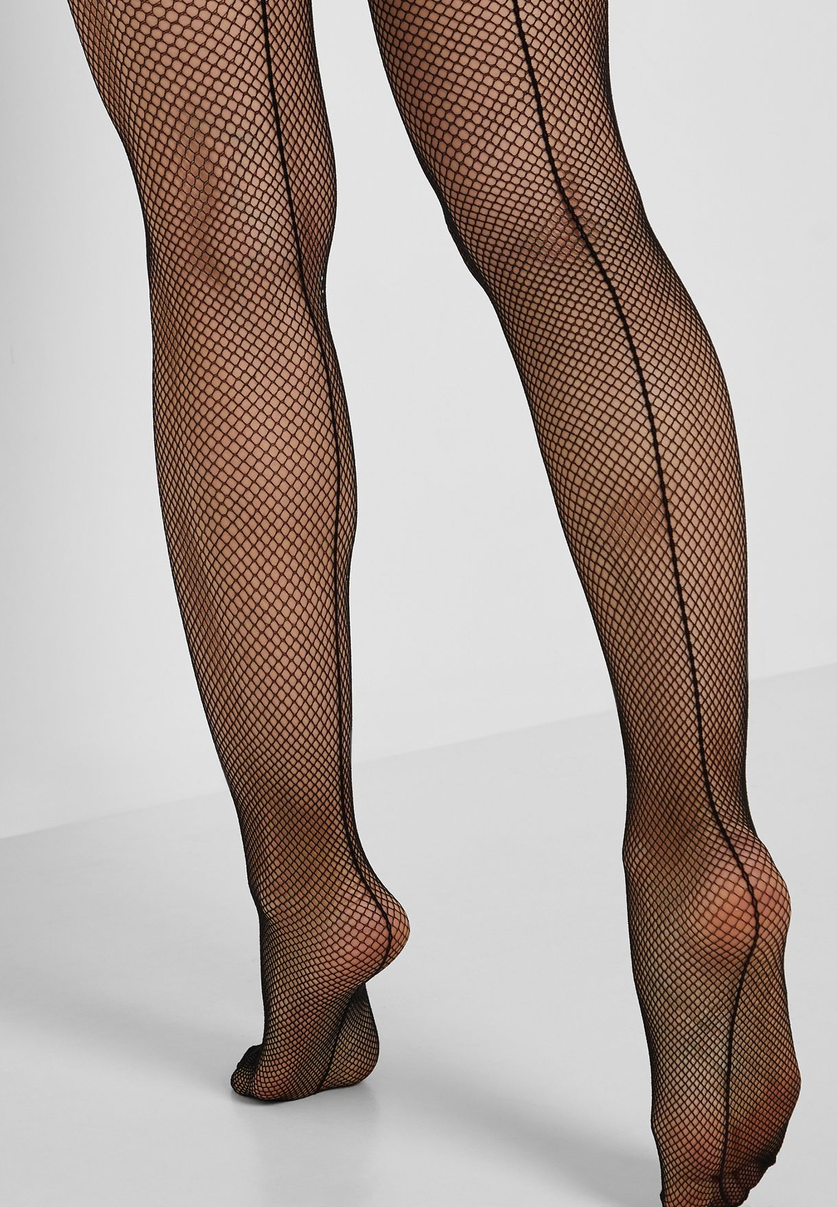 ade8383359894 Shop Forever 21 black Sheer Fishnet Tights 328938 for Women in Qatar ...